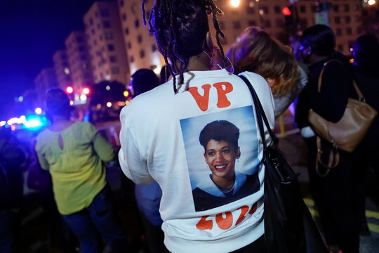 Zipporaa Taylor of Washington DC wears a sweatshirt she made featuring an image of Vice President-elect Kamala Harris at Black Lives Matter Plaza near the White House, in in Washington