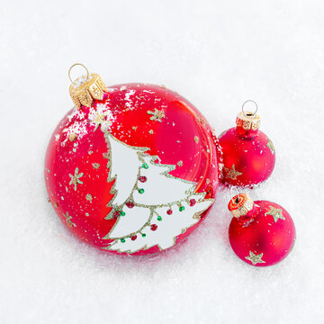 Christmas Red Ball with Tree Decorations, Pine cone and and frosty snow  background. Top view