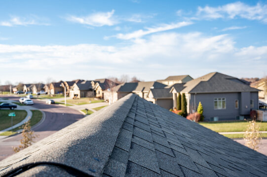 View down the top of an Asphalt shingle roof with ridge cap