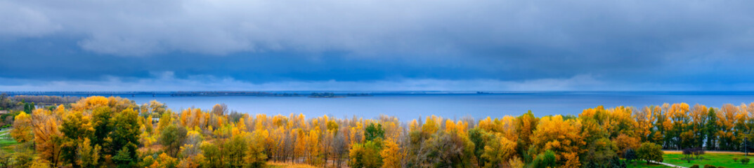 Autumn landscape. Golden autumn. View of the forest and the river. Panoramic view.