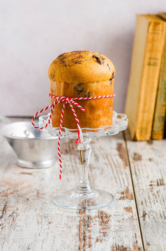 Little panettone with chocolate. Traditional Italian dessert for Christmas. Front view.