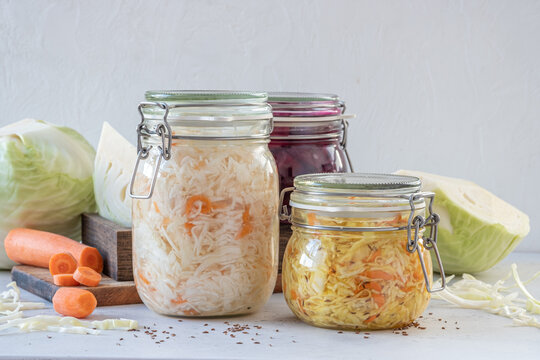 Fermented preserved vegetarian food concept. Cabbage sauerkraut sour glass jars