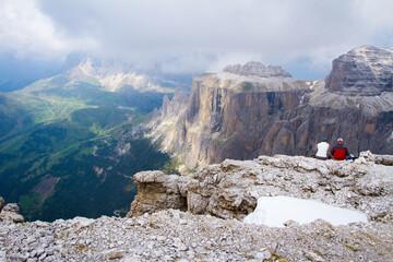 couple in high mountains wondering beautiful landscape view, dolomites, italy, passo pordoi
