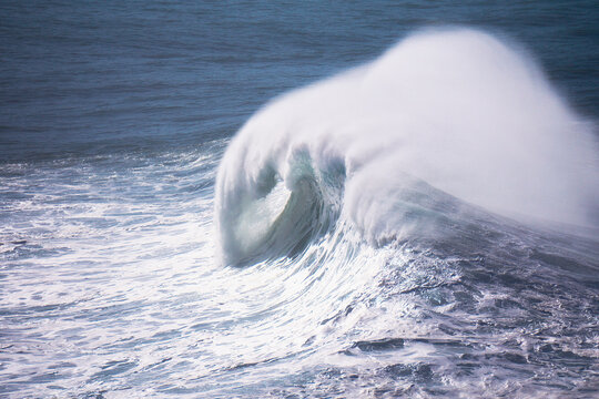 big wave breaking with spray