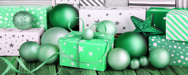 Green Christmas gifts and decorations close up