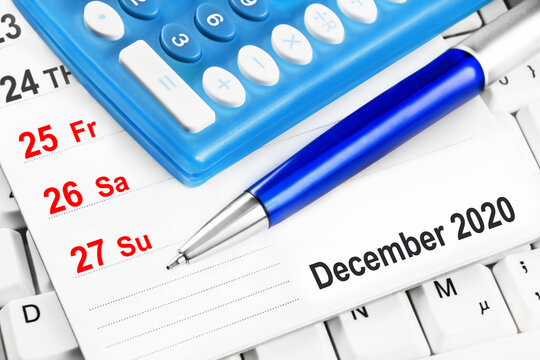 Christmas holidays and calculator against calendar