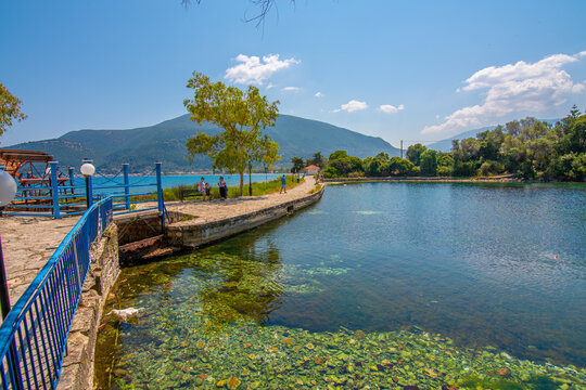 Karavomilos lake with colorful calm waters in Kefalonia Greece.