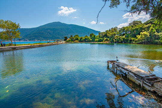 View of  Karavomilos lake with colorful calm waters in Kefallonia Greece