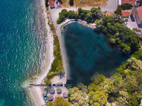 Aerial panoramic view of the famous lake Karavomilos in Kefalonia Greece