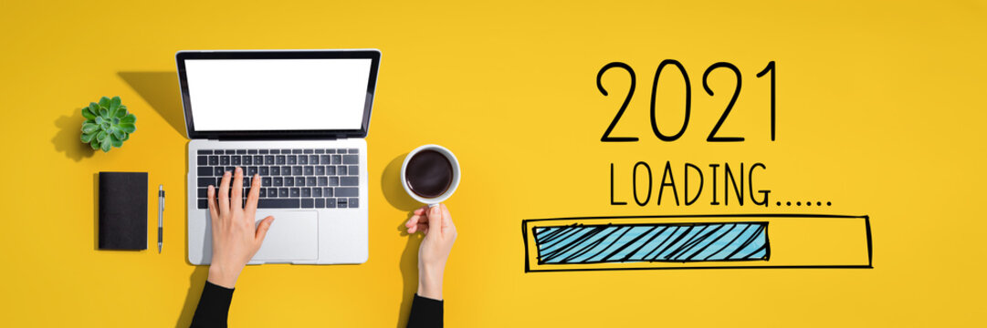 Loading new year 2021 with person using a laptop computer