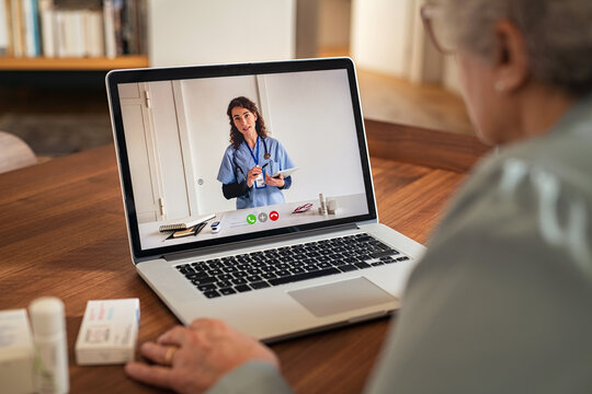 Senior woman in video tele medicine call with doctor