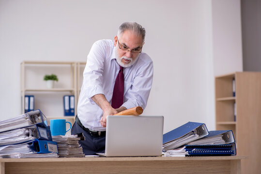 Aged male employee unhappy with excessive work