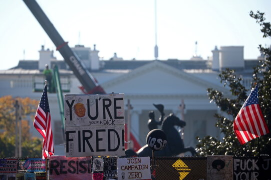 "A ""You're Fired"" sign hangs atop a fence in front of the White House, days after former Vice President Joe Biden was declared the winner of the 2020 U.S. presidential election, in Washington, DC"