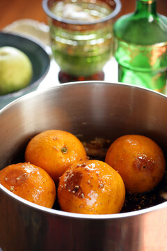 Oranges with water in pot