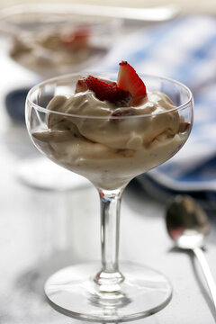 Close up of creamy dessert with strawberry