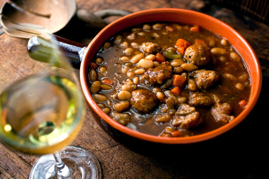 Close up of herbed white bean and sausage stew with balsamic vinegar