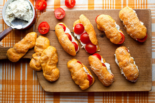 Close up of eclairs filled with tomatoes, ricotta and basil
