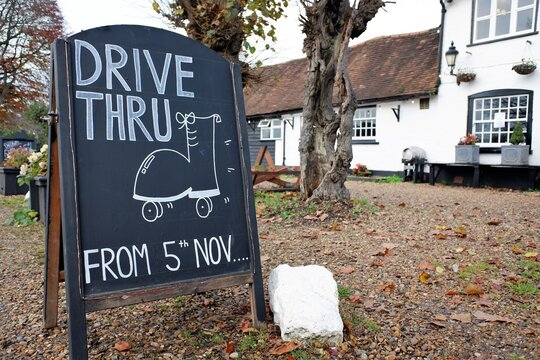 Sign outside pub advertising drive through meals during the UK's second lockdown which began on 5th November 2020