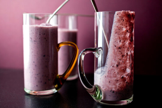 Mango blueberry smoothie in glasses