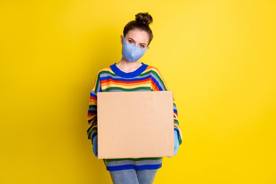 Photo of girl giving huge box wear blue mask gloves from corona rainbow sweater pants isolated on bright yellow color background