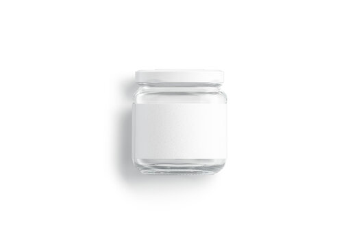 Blank small glass jar with white label mockup lying, isolated