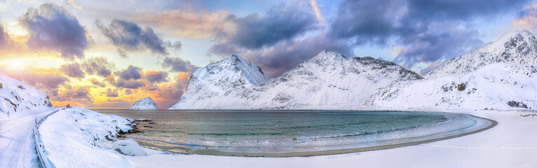 Fototapeta Fantastic winter view of Vik and Haukland beaches during sunset with lots of snow  and snowy  mountain peaks near Leknes