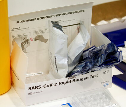 A box containing fast test sets is seen at a newly-opened COVID-19 testing site in Zurich