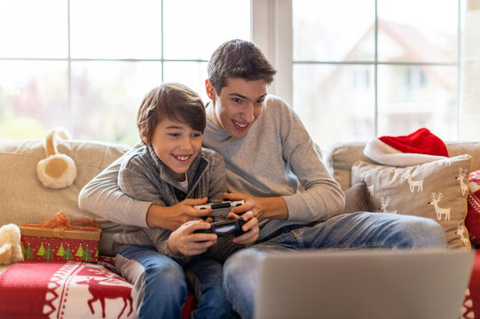 Two Brothers Playing Computer Games at Christmas Time