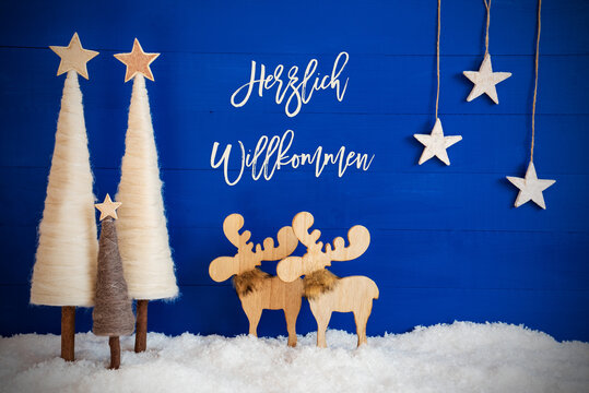German Calligraphy Herzlich Willkommen Means Welcome On Blue Background With Snow. Decoration Like Crhistmas Trees, Moose And Stars.