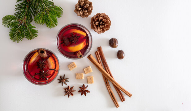 Mulled wine, Christmas hot drink in cups on white background