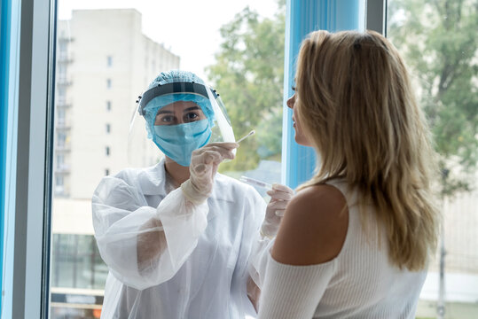 female doctors taking sample with cotton swab in potential patient