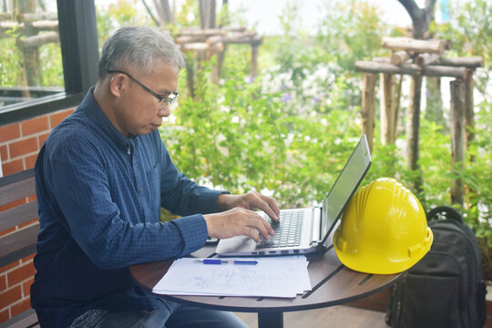 Engineer on laptop with PPE