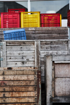 Stack of shabby boxes in port