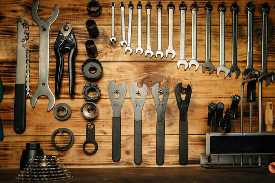 Set of tools on the wooden rack