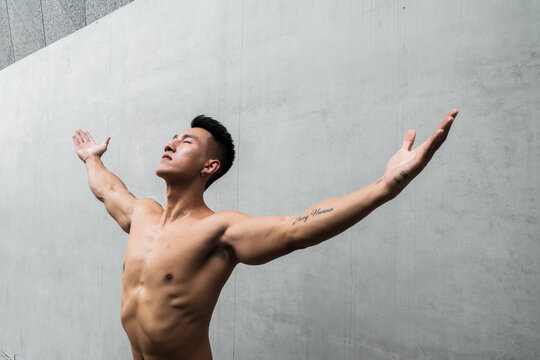 A Chinese man is exercising in the city