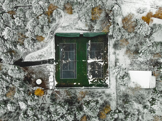Aerial view of tennis court covered with snow