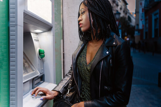 Girl On An ATM At Night.
