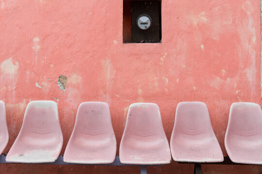 A row of empty seats on a bus stop in Mexico