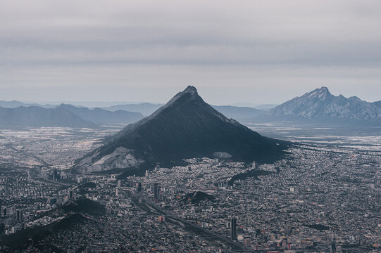 From above shot of a Monterrey cityscape against the giant mountain