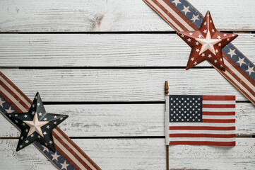 American stars and stripes flat lay over rustic wood background