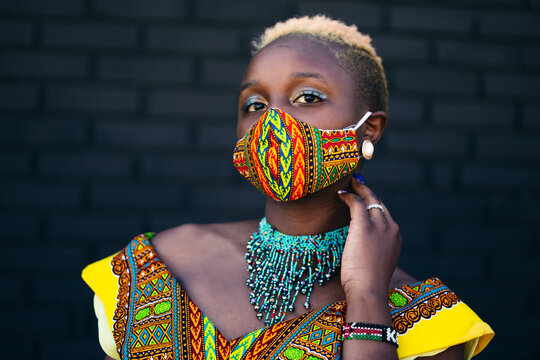 Woman wearing African inspired face mask during covid-19 pandemic