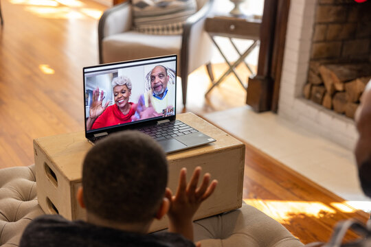 Family having a video chat  with grandparents on laptop at home for Christmas