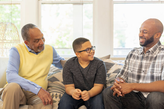 Multigenerational black men talking at home during Christmas