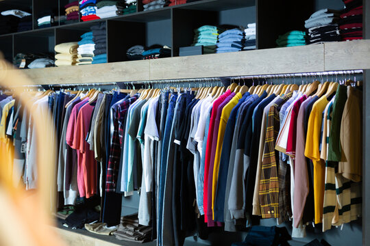 Clothes on hangers and shelves in apparel market