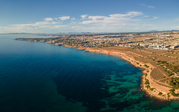 The east coast of Spain near Orihuela photographed from the air in autumn in sunshine. There is little wind. That's why you can see the sea floor.