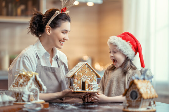 Family cooking gingerbread house