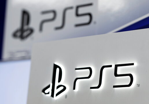 The logos of Sony PlayStation 5 are displayed at the consumer electronics retailer chain Bic Camera, ahead of its official launch, in Tokyo