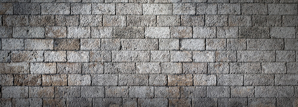 Large and dirty stone wall decorative background, grey stone wall texture banner