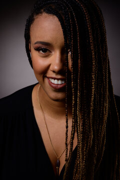Beauty portrait of a n afro american woman over dark background black lifes matters