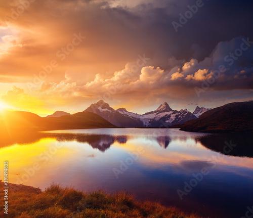 Wall mural Picturesque view of the Schreckhorn and Wetterhorn mountains at sunset.